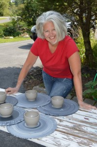 K Robertson-drying pots on a sunny day outside studio